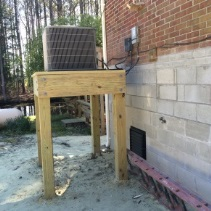 Wood frame to elevated an HVAC unit.