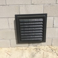 Louvered Vent in side of house.