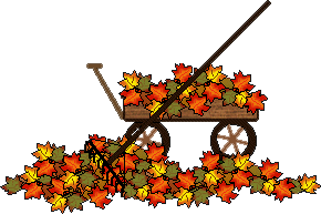 Wagon full of leaves, rake beside with leaves all around.