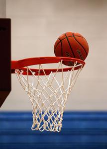 Basketball on rim.