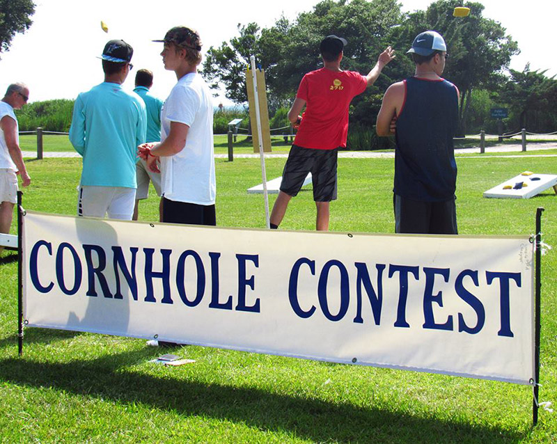 Cornhole Contest banner with players in the background.