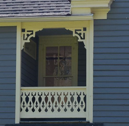 Detailed view of rear porch rail and brackets.