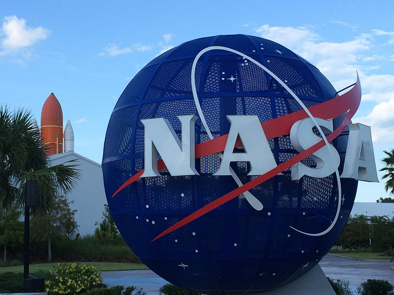 NASA icon with space ship in background.