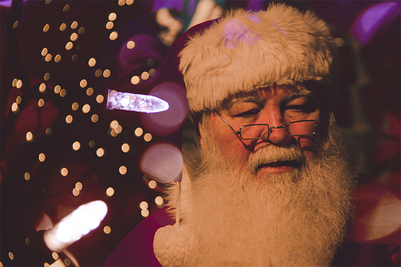 Santa's head with light beside him.