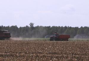 Farm equipment plowing a field.