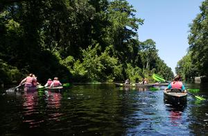 Teens kayaking.