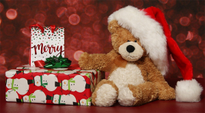 Christmas gifts with teddy bear with a Santa Hat.