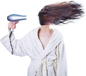 Women with hair dryerblowing her hair..