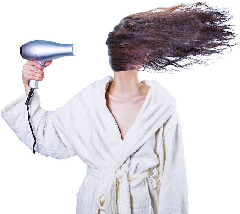 Women with hair dryer blowing her hair.